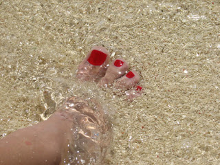 rp_Belize-4-Silk-Caye-foot-and-red-painted-toes-on-the-beach-in-sand-and-water.jpg